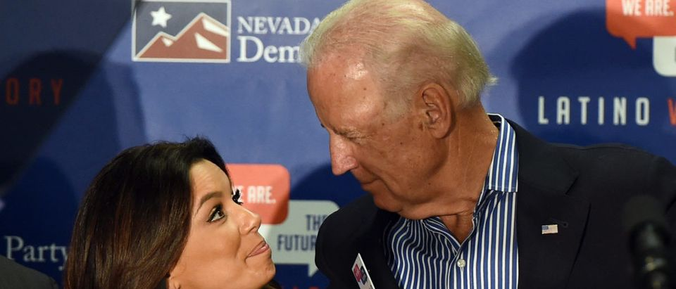 Actress Eva Longoria (L), co-founder of the Latino Victory PAC, and U.S. Vice President Joe Biden embrace after speaking at a get-out-the-vote rally at a union hall on November 1, 2014 in Las Vegas, Nevada. (Photo by Ethan Miller/Getty Images)