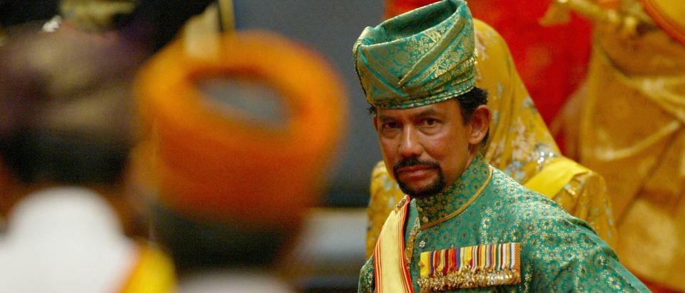 The sultan of Brunei attends the powdering ceremony of his son at The Sultans Palace Diraja on Sept. 5, 2004 in Bandar Seri Begawan, Brunei. (Photo by Christopher Furlong/Getty Images)