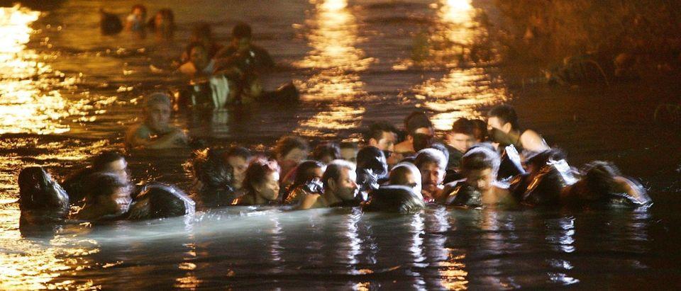 Migrants Attempt To Illegally Cross Mexican Border Into California