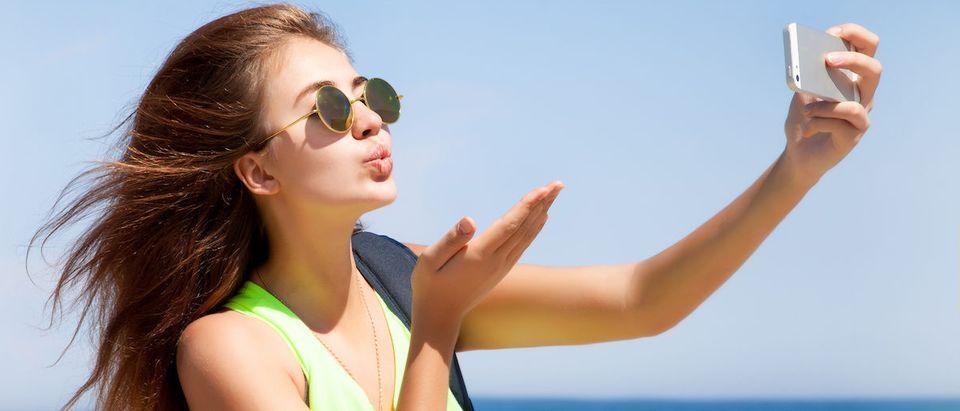 Girl_Taking_Selfie Shutterstock/ Diana Indiana