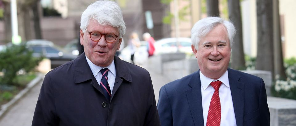 Greg Craig (L), former White House counsel under President Barack Obama, arrives at a U.S. district court for his arraignment on April 12. (Win McNamee/Getty Images)