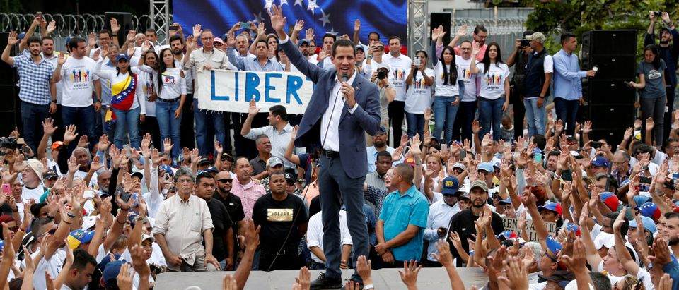 Venezuelan opposition leader Juan Guaido, who many nations have recognised as the country's rightful interim ruler, speaks during a swearing-in ceremony for supporters in Caracas, Venezuela April 27, 2019. REUTERS/Carlos Garcia Rawlins/File Photo