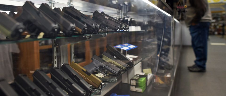 A man looks at handguns at the RTSP shooting range in Randolph New Jersey, on Dec. 9, 2015.(Photo by JEWEL SAMAD/AFP/Getty Images)