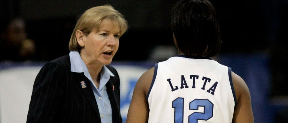 University of North Carolina head coach Sylvia Hatchell talks with guard Ivory Latta in the second half of their NCAA women's regional semi-final basketball game in Dallas, Texas, March 25, 2007. REUTERS/Mike Stone