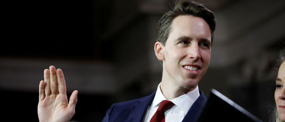 Sen. Josh Hawley (R-MO) participates in a mock swearing in with U.S. Vice President Mike Pence during the opening day of the 116th Congress on Capitol Hill in Washington