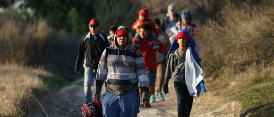 Central American migrants walk along the Mexican bank of the Rio Bravo that divides the cities of Eagle Pass, Texas and Piedras Negras. (Julio Cesar Aguilar/AFP/Getty Images)