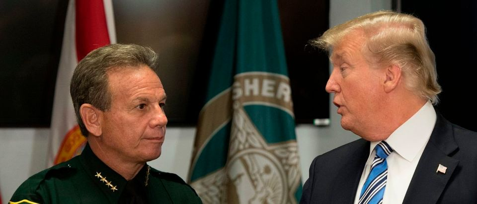 U.S. President Donald Trump (R) speaks with Broward County Sheriff Scott Israel (L) while visiting first responders at Broward County Sheriff's Office in Pompano Beach, Florida, on Feb. 16, 2018, three days after a mass shooting that claimed 17 lives at a nearby high school. (Photo by JIM WATSON/AFP/Getty Images)