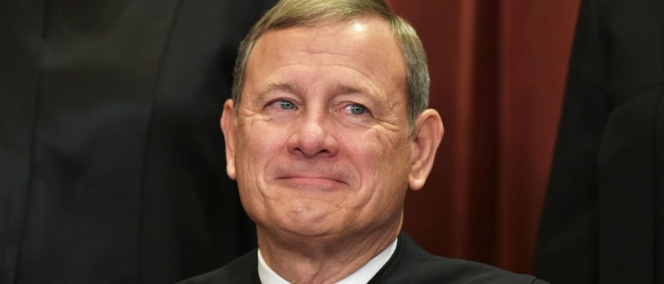 Chief Justice John Roberts poses for the official group photo at the Supreme Court on November 30, 2018. (Mandel Ngan/AFP/Getty Images)