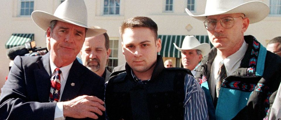 """John William """"Bill"""" King (C) is led from the Jasper County Courthouse by deputies following the first day of jury selection in his January murder trial in Jasper, Texas. (Photo credit: PAUL BUCK/AFP/Getty Images)"""
