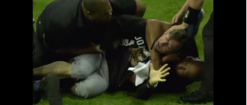 LFL (Credit: Screenshot/TMZ Video https://www.tmz.com/2019/04/18/legends-football-league-fan-choked-out-storming-field/)