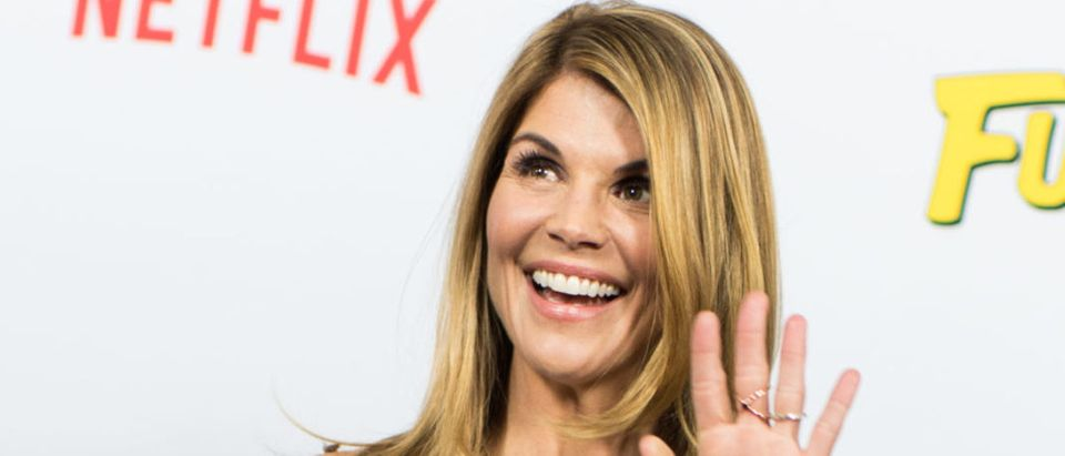 Actress Lori Loughlin attends the premiere of Netflix's 'Fuller House' at Pacific Theatres at The Grove on February 16, 2016 in Los Angeles, California. (Photo by Emma McIntyre/Getty Images)