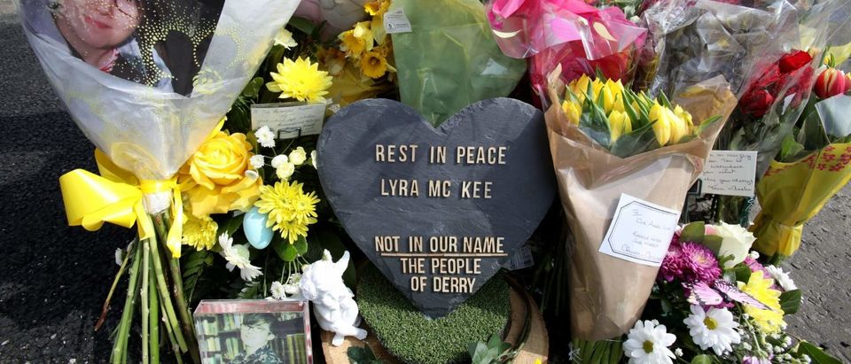 A picture shows the floral tributes placed at the scene in the Creggan area of Derry (Londonderry) in Northern Ireland on April 20, 2019 where journalist Lyra McKee was fatally shot amid rioting on April 18. (PAUL FAITH/AFP/Getty Images)