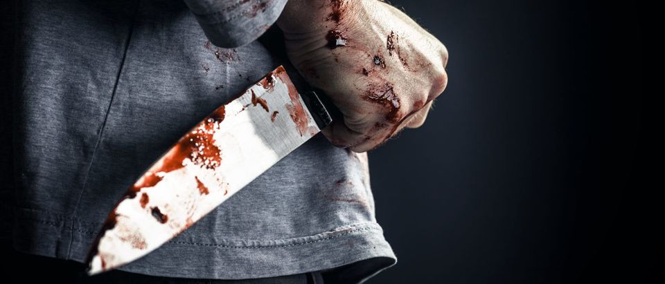A man is pictured with a knife.(Shutterstock/gualtiero boffi)