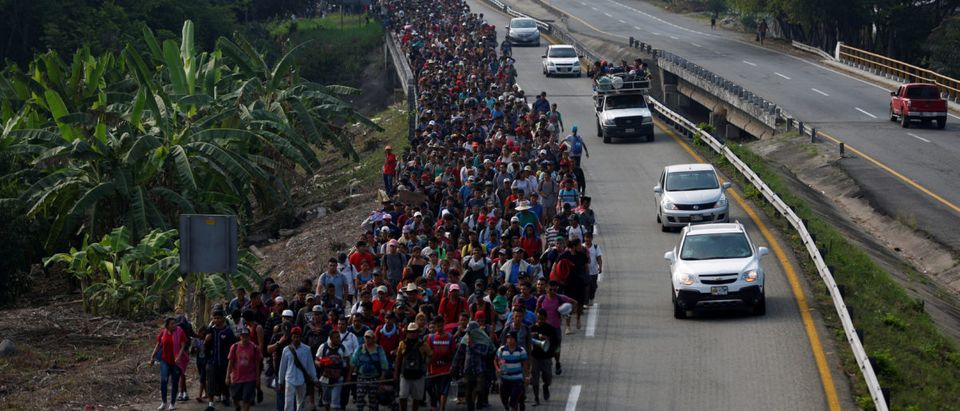 Central American migrants walk during their journey towards the United States, in Villa Comaltitlan