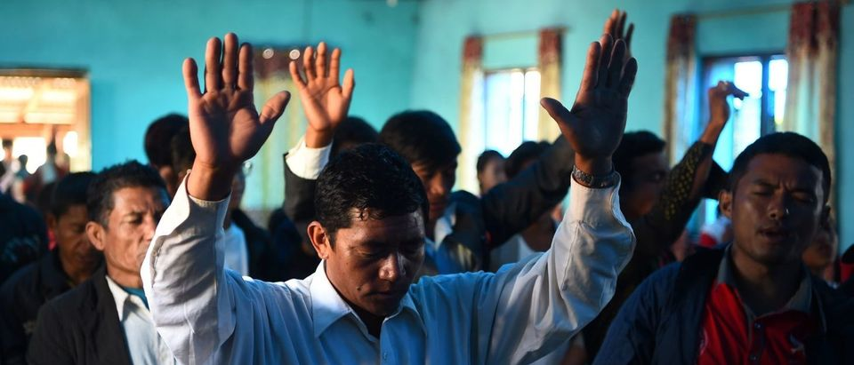 In this photograph taken on Oct. 8, 2017, Nepali Christians take part in a church service in Lapa village in Dhading, some 100 kms northwest of Kathmandu. (PRAKASH MATHEMA/AFP/Getty Images)