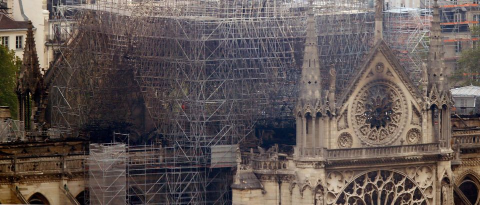 A view shows Notre-Dame Cathedral after a massive fire devastated large parts of the gothic structure in Paris, France, April 16, 2019. REUTERS/Charles Platiau