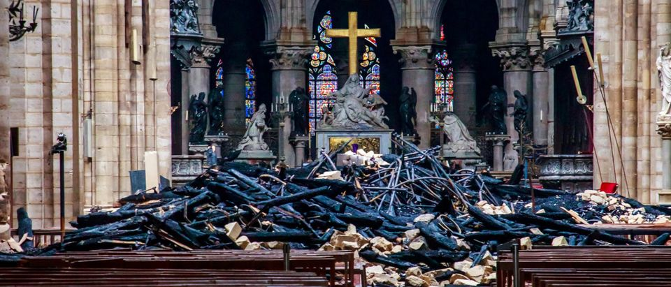 A view of the debris inside Notre-Dame de Paris in the aftermath of a fire that devastated the cathedral, during the visit of French Interior Minister Christophe Castaner (not pictured) in Paris, France, April 16, 2019. Christophe Petit Tesson/Pool via REUTERS