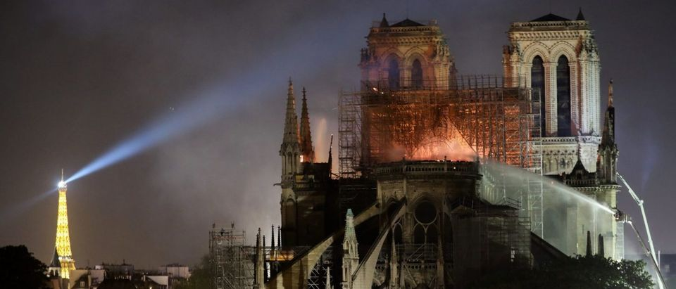 Firefighters douse flames billowing from the roof at Notre-Dame Cathedral in Paris on April 15, 2019. (LUDOVIC MARIN/AFP/Getty Images)