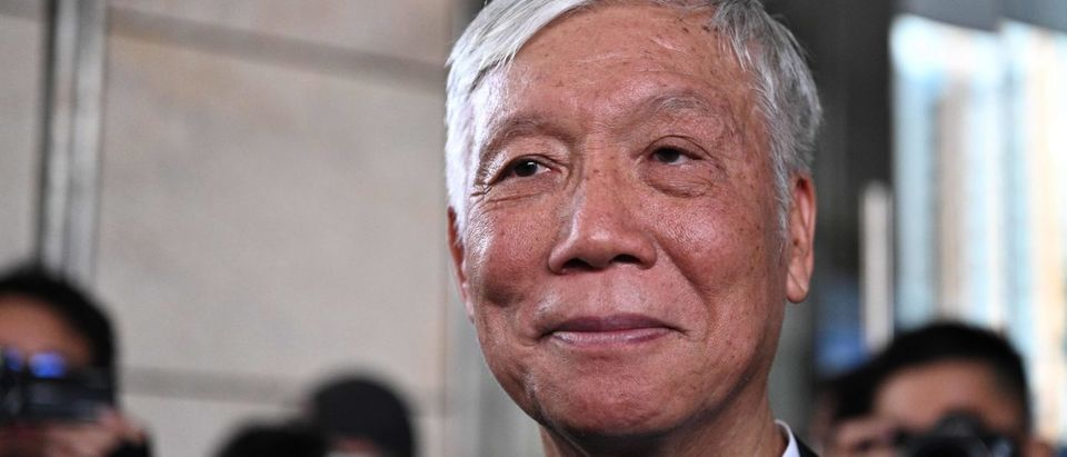 "Baptist church minister Chu Yiu-ming reacts as he and other pro-democracy campaigners leave the West Kowloon Magistrates Court in Hong Kong on April 9, 2019, after being convicted on colonial-era ""public nuisance"" charges for their role in organising the 2014 mass pro-democracy protests that paralysed the city for months and infuriated Beijing. (ANTHONY WALLACE/AFP/Getty Images)"