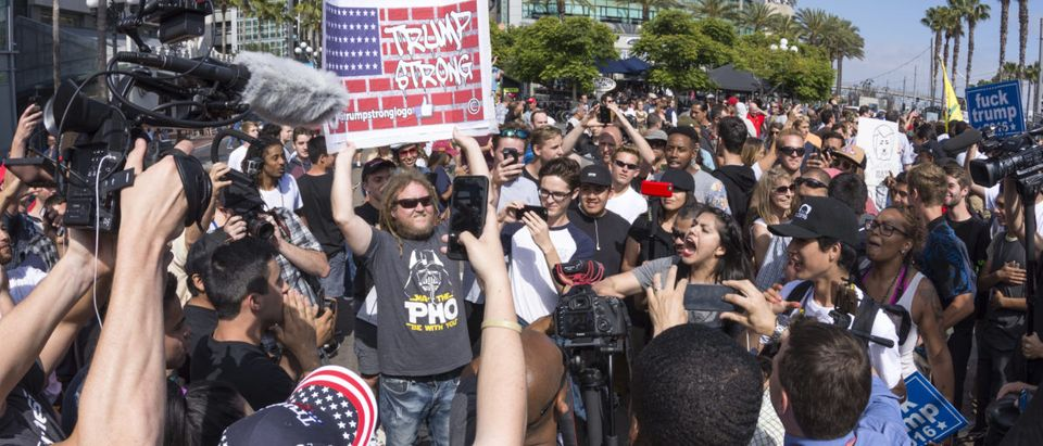 Huge groups of protesters clash with Trump supporters in a verbal exchange outside a Trump rally at the San Diego Convention Center