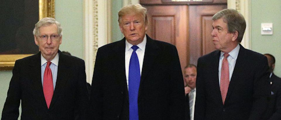 President Donald Trump (C) walks with Senate Majority Leader Sen. Mitch McConnell (R-KY) (L), and Sen. Roy Blunt (R-MO) (R) as he arrives at a Senate Republican weekly policy luncheon at the U.S. Capitol March 26, 2019 in Washington, DC