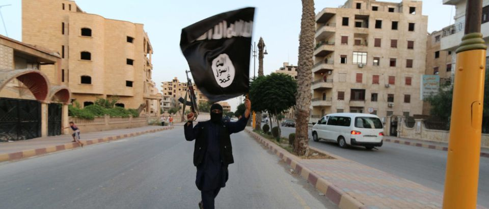 "A member loyal to the Islamic State in Iraq and the Levant (ISIL) waves an ISIL flag in Raqqa June 29, 2014. The offshoot of al Qaeda which has captured swathes of territory in Iraq and Syria has declared itself an Islamic ""Caliphate"" and called on factions worldwide to pledge their allegiance, a statement posted on jihadist websites said on Sunday. The group, previously known as the Islamic State in Iraq and the Levant (ISIL), also known as ISIS, has renamed itself ""Islamic State"" and proclaimed its leader Abu Bakr al-Baghadi as ""Caliph"" - the head of the state, the statement said. REUTERS/Stringer"