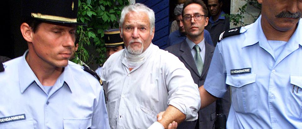 FUGITIVE FORMER HIPPIE GURU IRA EINHORN LEAVES HOME UNDER FRENCHGENDARME ESCORT.