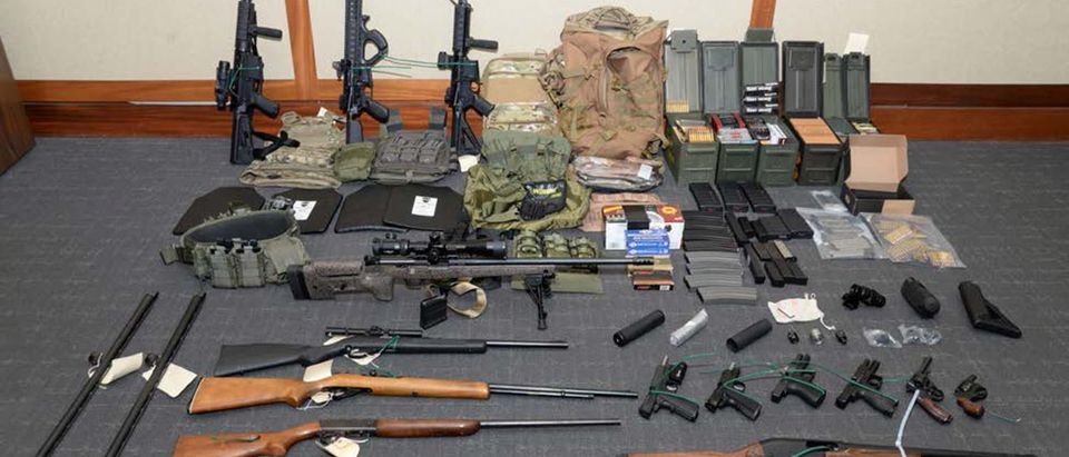 Handout photo of a cache of guns and ammunition uncovered by U.S. federal investigators in the home of U.S. Coast Guard lieutenant Christopher Paul Hasson in Silver Spring, Maryland