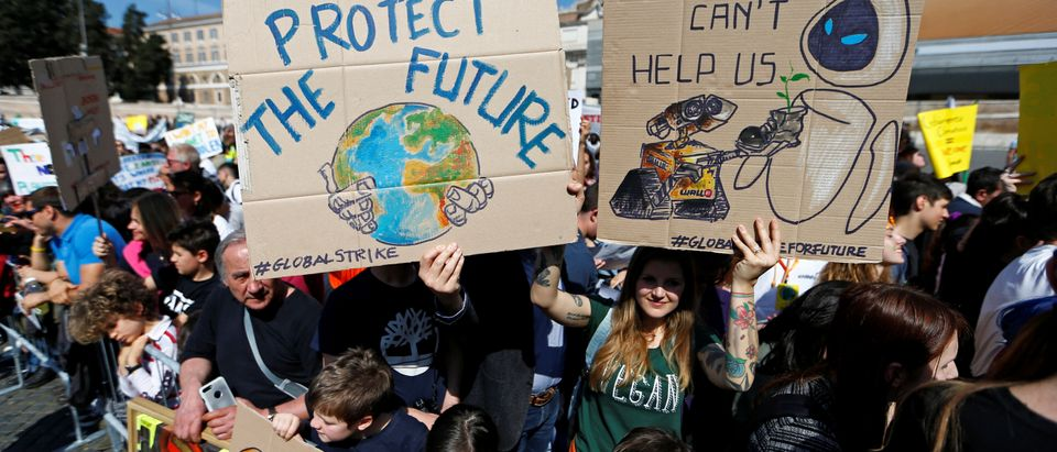 Students hold banners during a protest to demand action on climate change, in Piazza del Popolo, Rome, Italy, April 19, 2019. REUTERS/Yara Nardi