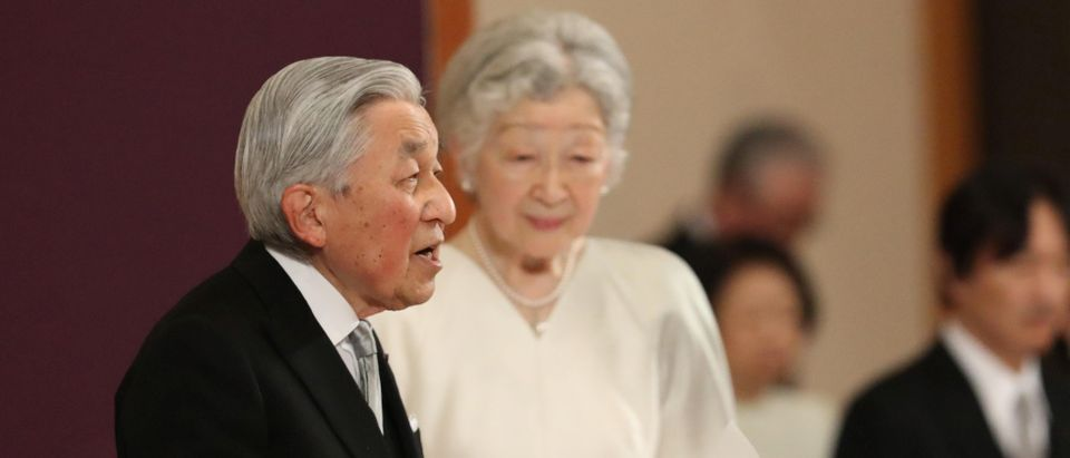 Japan's Emperor Akihito, flanked by Empress Michiko, delivers a speech during a ritual called Taiirei-Seiden-no-gi, a ceremony for the Emperor's abdication, at the Imperial Palace in Tokyo