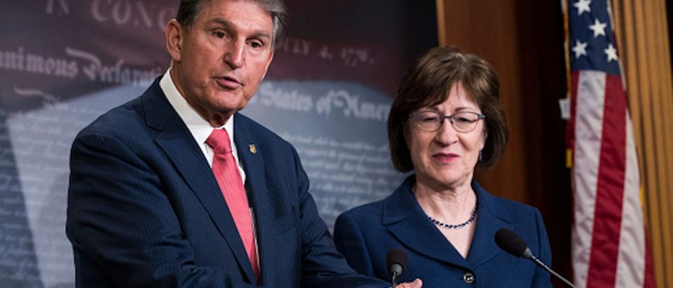 Sen. Joe Manchin (D-WV) and Sen. Susan Collins (R-ME) speak during a press conference after the Senate passed a procedural vote for a continuing resolution to fund the federal government, Capitol Hill, January 22, 2018 in Washington, DC