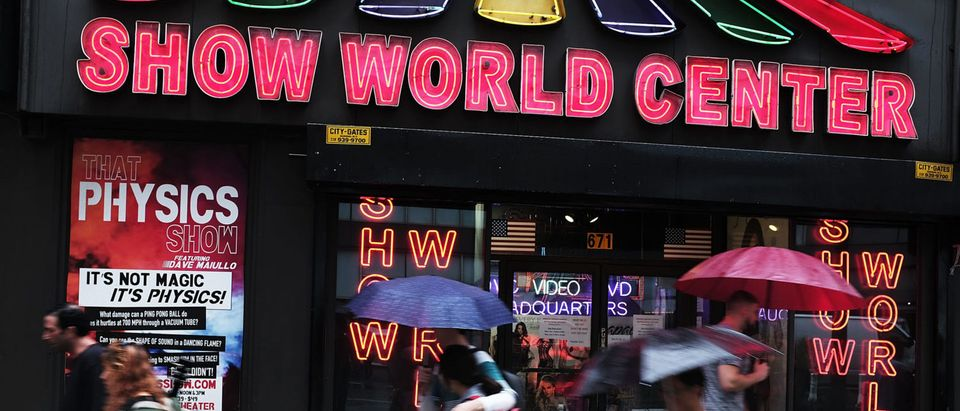 "Pedestrians walk by one of the few remaining adult DVD stores in Times Square on August 7, 2017. The owners of the city's remaining peep shows, adult DVD stores and strip clubs say a recent court ruling could put them out of business. The state Court of Appeals has reinstated rules that date to 2001 forbidding any business with ""live performances characterized by an emphasis on certain specified anatomical areas or specified sexual activities, as well as sexually explicit videos from all but a few selected city zones. Once home to dozens of peep shows and pornography cinemas, only a few now survive following a crack down that started with former Mayor Rudy Giuliani and his effort to clean-up Times Square in the 1990s. (Photo by Spencer Platt/Getty Images)"