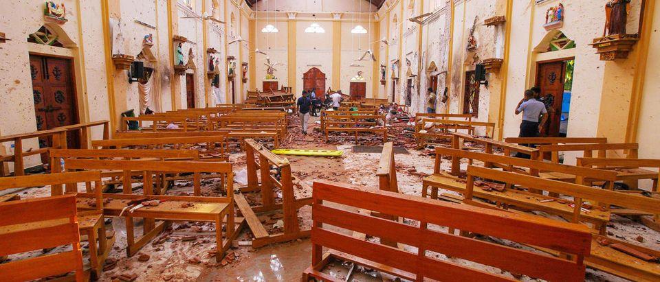 Crime scene officials inspect the site of a bomb blast inside St Sebastian's Church in Negombo, Sri Lanka April 21, 2019. REUTERS/Stringer