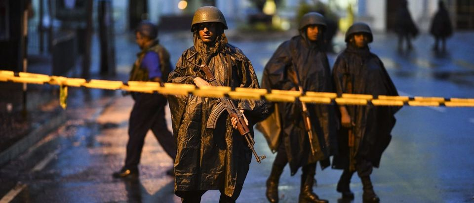 Sri Lankan soldiers stand guard under the rain at St. Anthony's Shrine in Colombo on April 25, 2019, following a series of bomb blasts targeting churches and luxury hotels on the Easter Sunday in Sri Lanka.(JEWEL SAMAD/AFP/Getty Images)