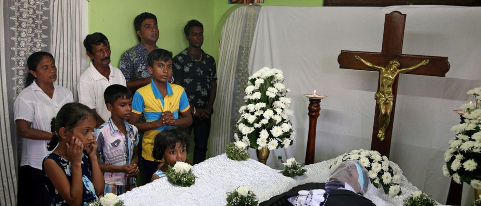 Friends and relatives pray near the body of Muthuwadige George Dencil Fernando, 64, who died as bomb blasts ripped through churches and luxury hotels on Easter, in Negombo, Sri Lanka April 22, 2019. REUTERS/Athit Perawongmetha