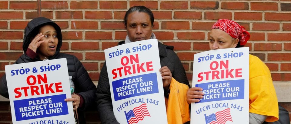 Striking workers gather outside a Stop & Shop store following a speech by former U.S. Vice President Joe Biden, a potential 2020 Democratic presidential candidate, in Boston, Massachusetts, U.S., April 18, 2019. REUTERS/Brian Snyder