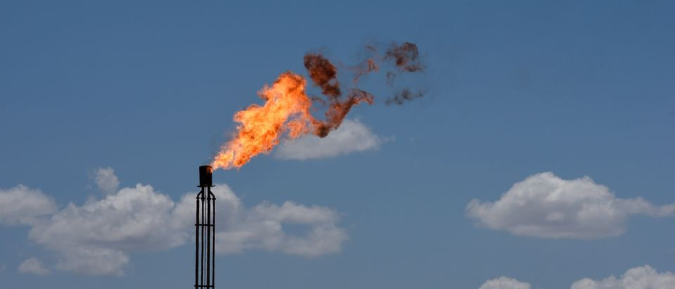A flare burns off excess gas from a gas plant in the Permian Basin oil production area near Wink