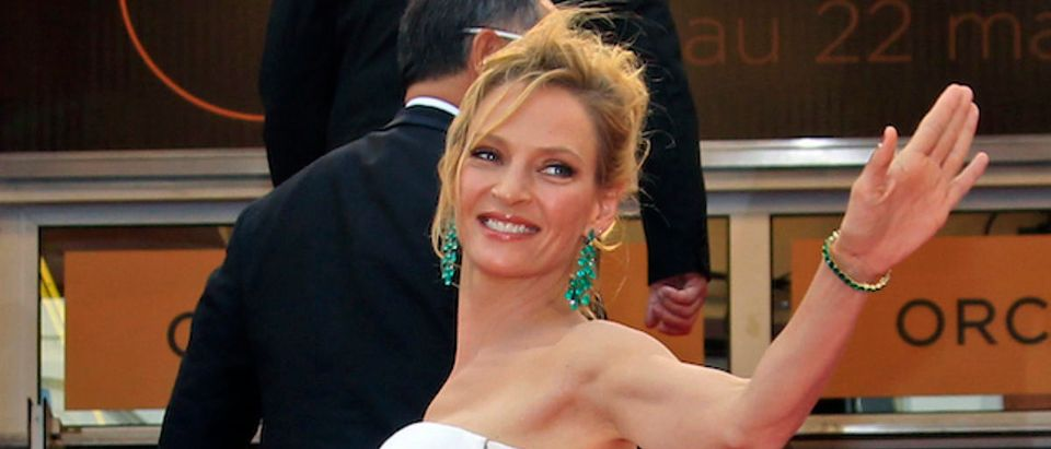 "Jury member Uma Thurman arrives on the red carpet for the screening of ""Midnight In Paris"" by director Woody Allen and for the opening ceremony of the 64th Cannes Film Festival in Cannes, May 11, 2011. Twenty films compete at the May 11 to 22 cinema showcase with an impressive roll call of major screen stars, revered ""auteur"" directors and relative newcomers. REUTERS/Jean-Paul Pelissier"