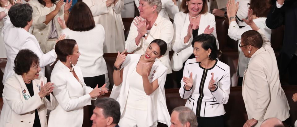 Democratic female members of Congress, including Rep. Alexandria Ocasio-Cortez (D-NY) (C), cheer after U.S. President Donald Trump said there are more women in Congress than ever before during his second State of the Union address to a joint session of the U.S. Congress in the House Chamber of the U.S. Capitol on Capitol Hill in Washington, U.S. February 5, 2019. REUTERS/Jonathan Ernst