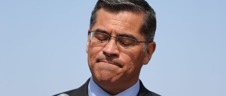 California Attorney General Xavier Becerra speaks about President Trump's proposal to weaken national greenhouse gas emission and fuel efficiency regulations, at a media conference in Los Angeles, California, Aug. 2, 2018. REUTERS/Lucy Nicholson