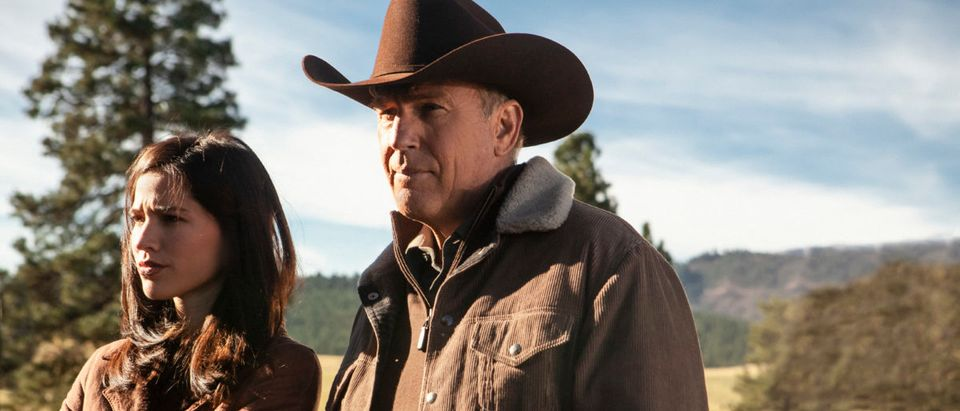 With his son feeling the heat from tribal police, John Dutton (R- Kevin Costner) makes a play to keep his son and his wife Monica (L-Kelsey Asbille) close to the Yellowstone Ranch. (Credit: Paramount Network)