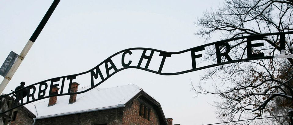 "The replacement of the sign ""Arbeit macht frei"" (Work will set you free) is seen in Auschwitz, Oswiecim December 18, 2009. REUTERS/Irek Dorozanski"