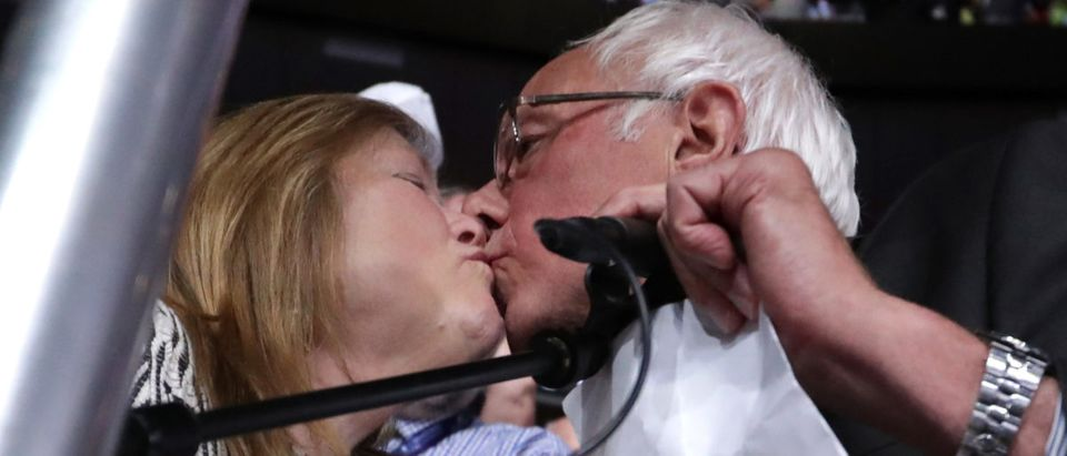 Sen. Bernie Sanders kisses his wife Jane O'Meara Sanders after the Vermont delegation cast their votes during roll call on the second day of the Democratic National Convention at the Wells Fargo Center, July 26, 2016 in Philadelphia, Pennsylvania. (Photo by Chip Somodevilla/Getty Images)