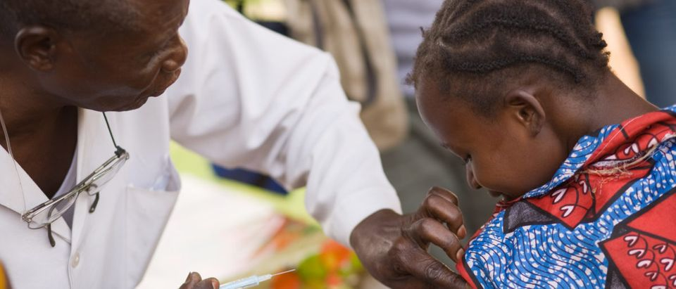 A child is vaccinated. Shutterstock image via Valeriya Anufriyeva