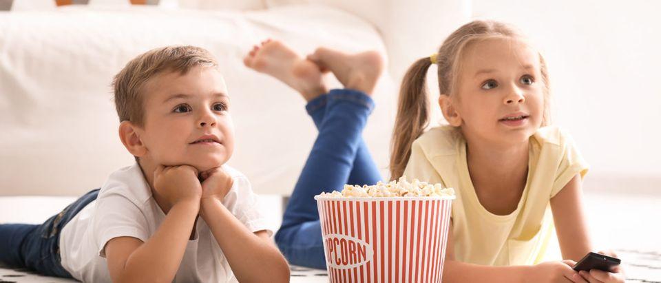 Children watch television. Shutterstock image via Pixel-Shot