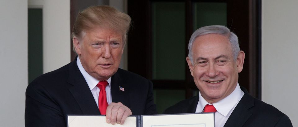 U.S. President Donald Trump (L) and Prime Minister of Israel Benjamin Netanyahu (R) show members of the media the proclamation Trump signed on recognizing Israel's sovereignty over Golan Heights after a meeting outside the West Wing of the White House March 25, 2019 in Washington, DC. (Photo by Alex Wong/Getty Images)