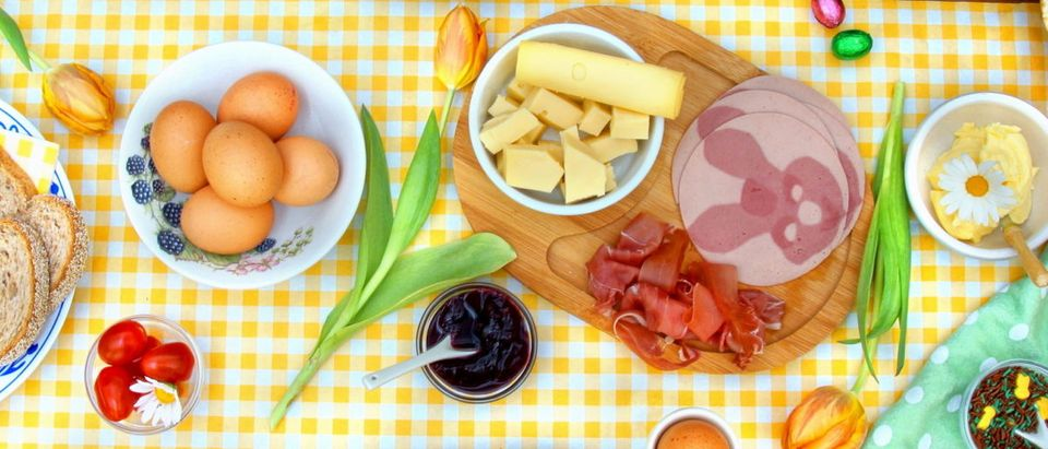 An Easter meal is on the table. Shutterstock image via Chantal de Bruijne