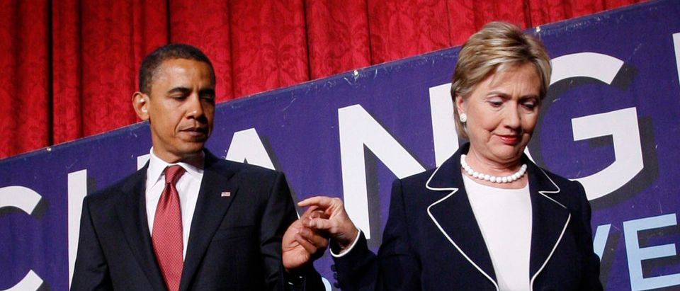 "U.S. Senator and Democratic Presidential candidate Barack Obama (D-IL) is led off the stage by U.S. Senator Hillary Clinton (D-NY) after the two appeared together at a ""Women for Obama"" campaign event in New York City, July 10, 2008. REUTERS/Mike Segar"