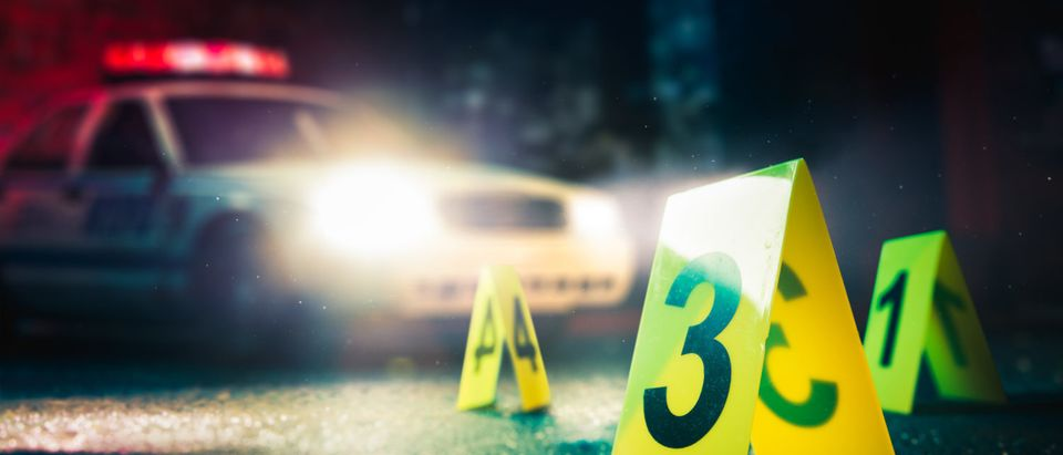 Police are at a crime scene. [Shutterstock - Fer Gregory]