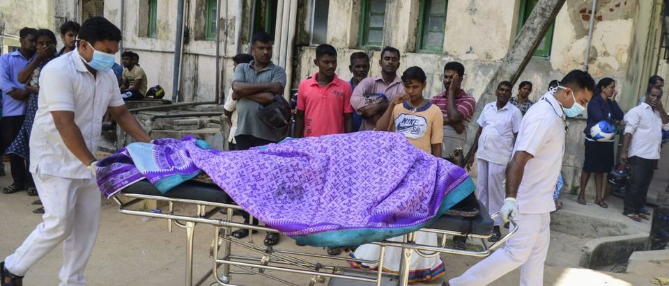 Sri Lankan hospital workers transport a body on a trolley at a hospital morgue following an explosion at a church in Batticaloa in eastern Sri Lanka on April 21, 2019. (LAKRUWAN WANNIARACHCHI/AFP/Getty Images)